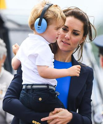 Duchess of Cambridge Kate protect Prince George's hearing at the Royal International Air Tattoo with a pair of Baby Banz Earmuff.